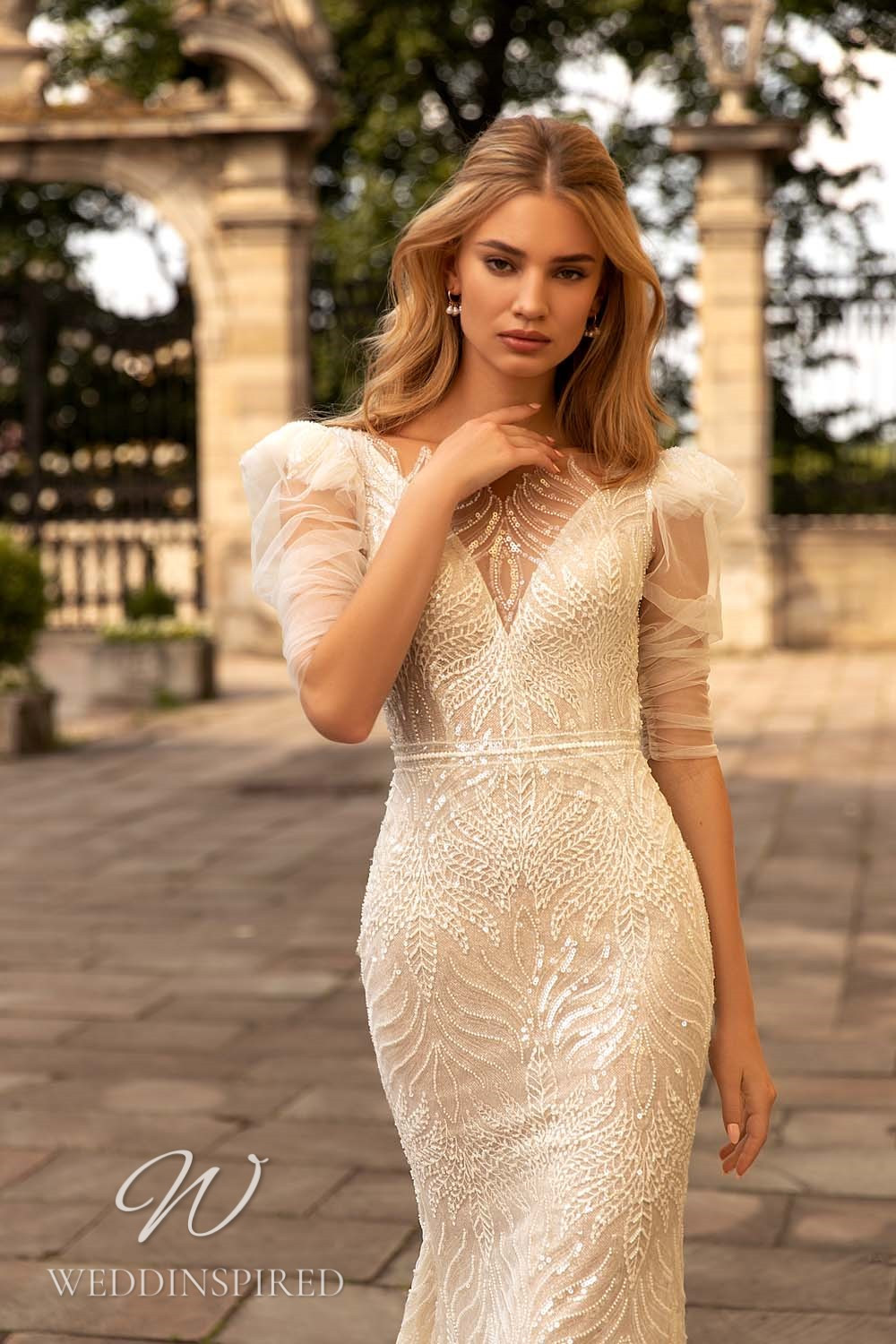 A WONÁ Concept 2021 ivory lace mermaid wedding dress with long sleeves