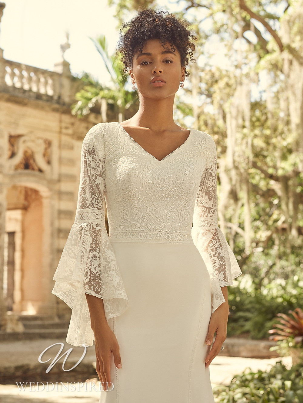 A Maggie Sottero 2021 boho lace and satin mermaid wedding dress