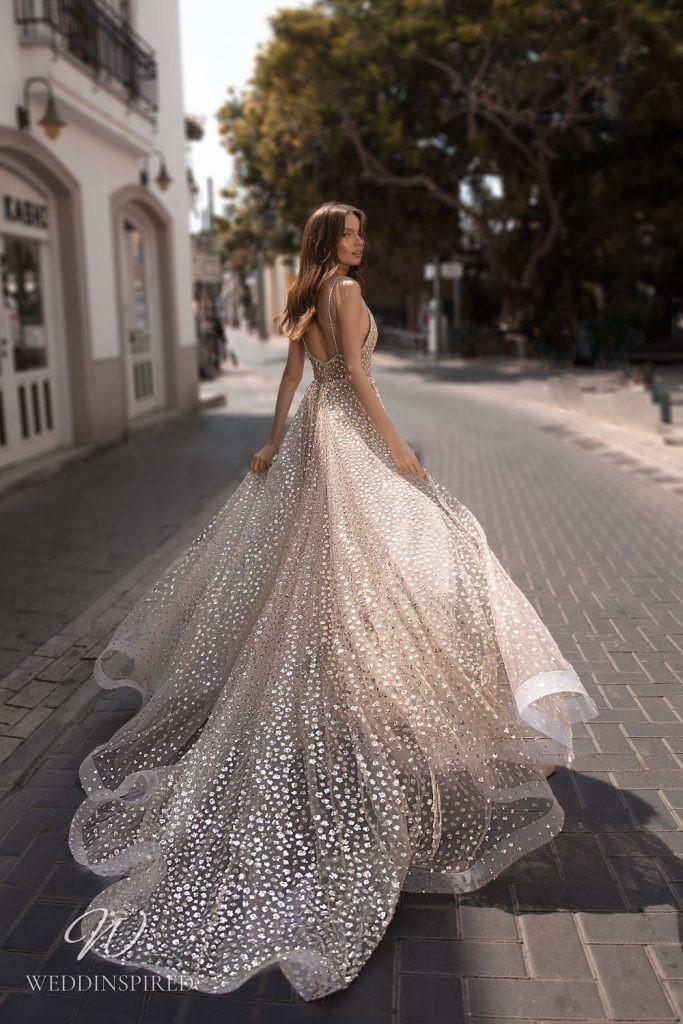 An Eden Aharon 2020 gold glitter sparkly A-line wedding dress with a high slit and a v neckline