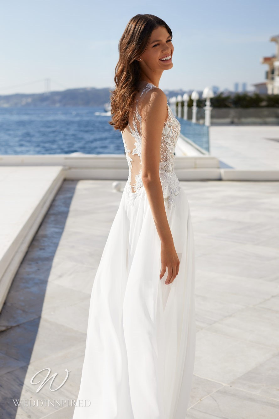 A Milla Nova 2021 lace and chiffon A-line wedding dress with beading and a low back