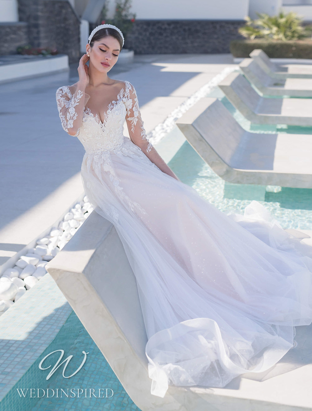 A Blunny 2021 lace and tulle A-line wedding dress with long sleeves