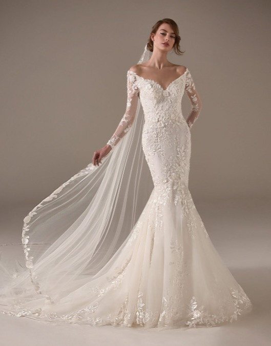 An off the shoulder, lace mermaid wedding dress with long sleeves