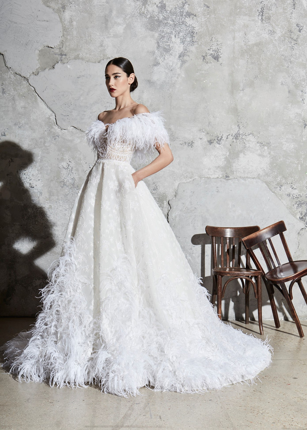 A Zuhair Murad off the shoulder feather and lace ball gown wedding dress