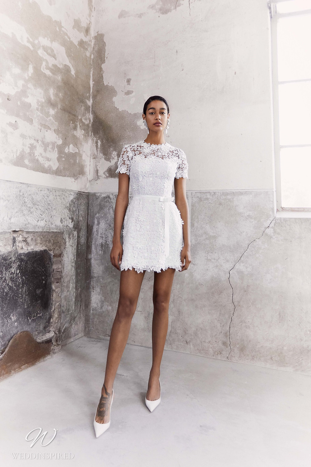 A Viktor & Rolf Fall/Winter 2021 short floral lace wedding dress with cap sleeves
