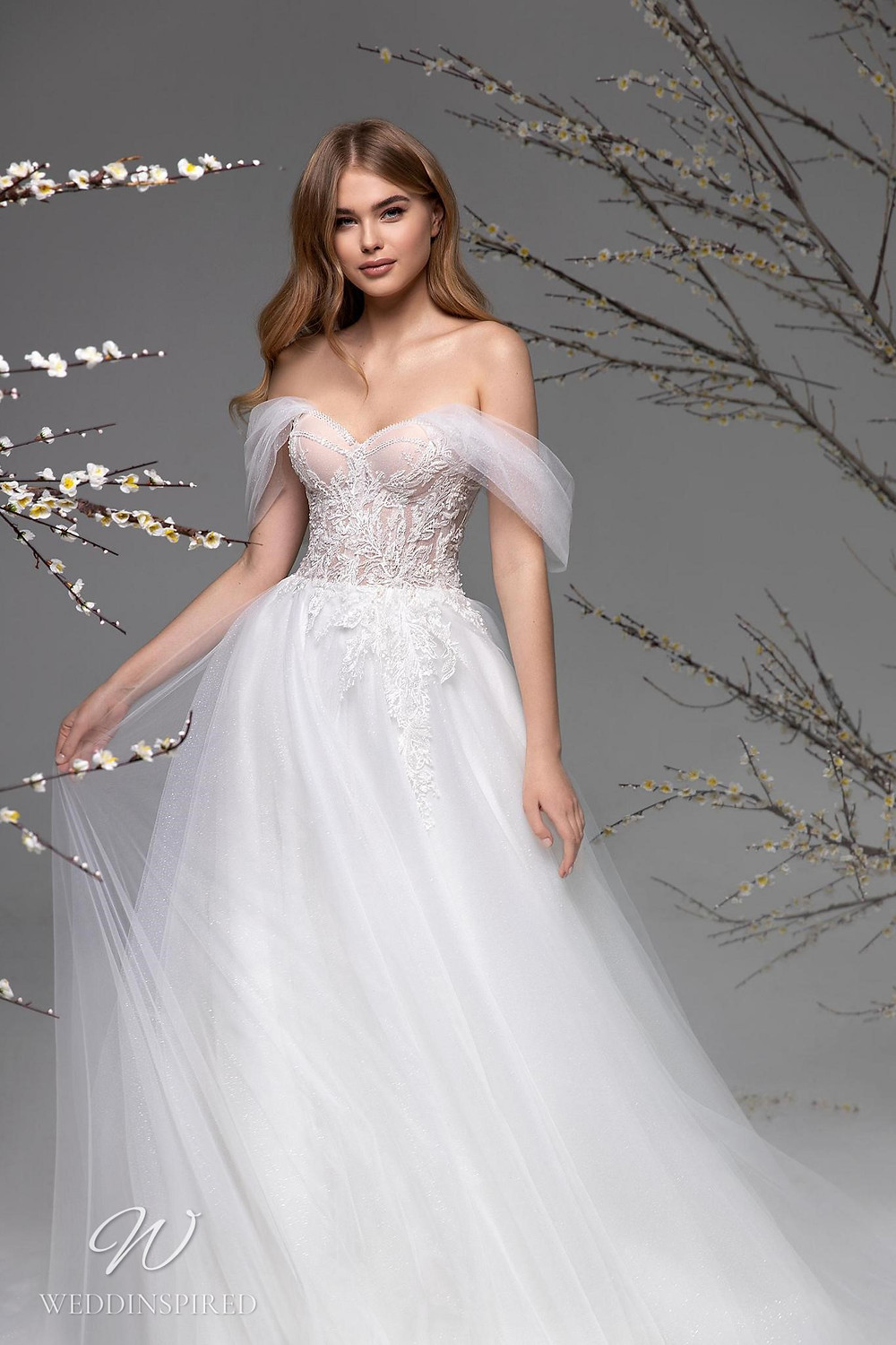 A Ricca Sposa off the shoulder mesh and lace A-line wedding dress