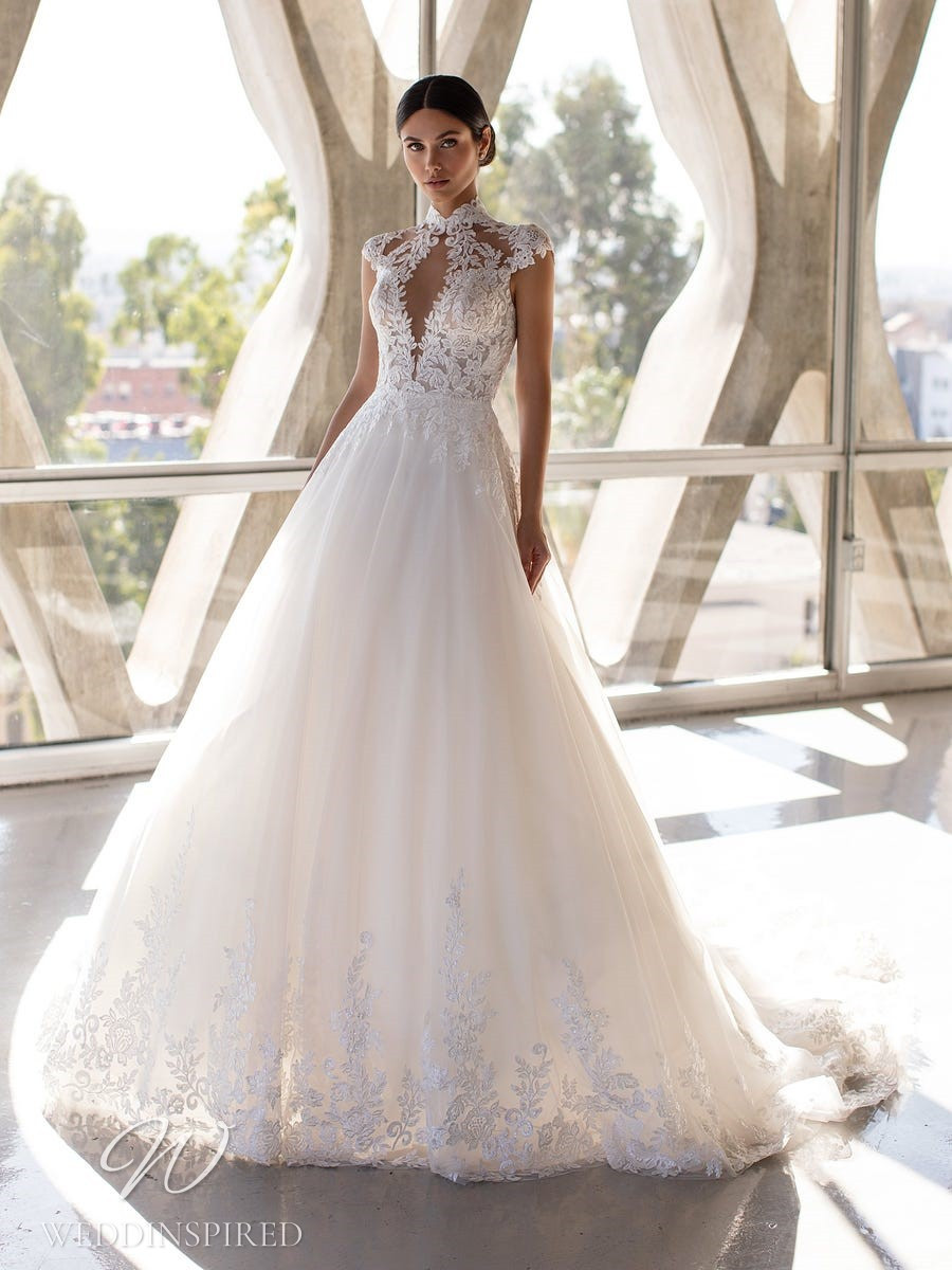 A Pronovias 2021 lace and tulle ball gown wedding dress with cap sleeves