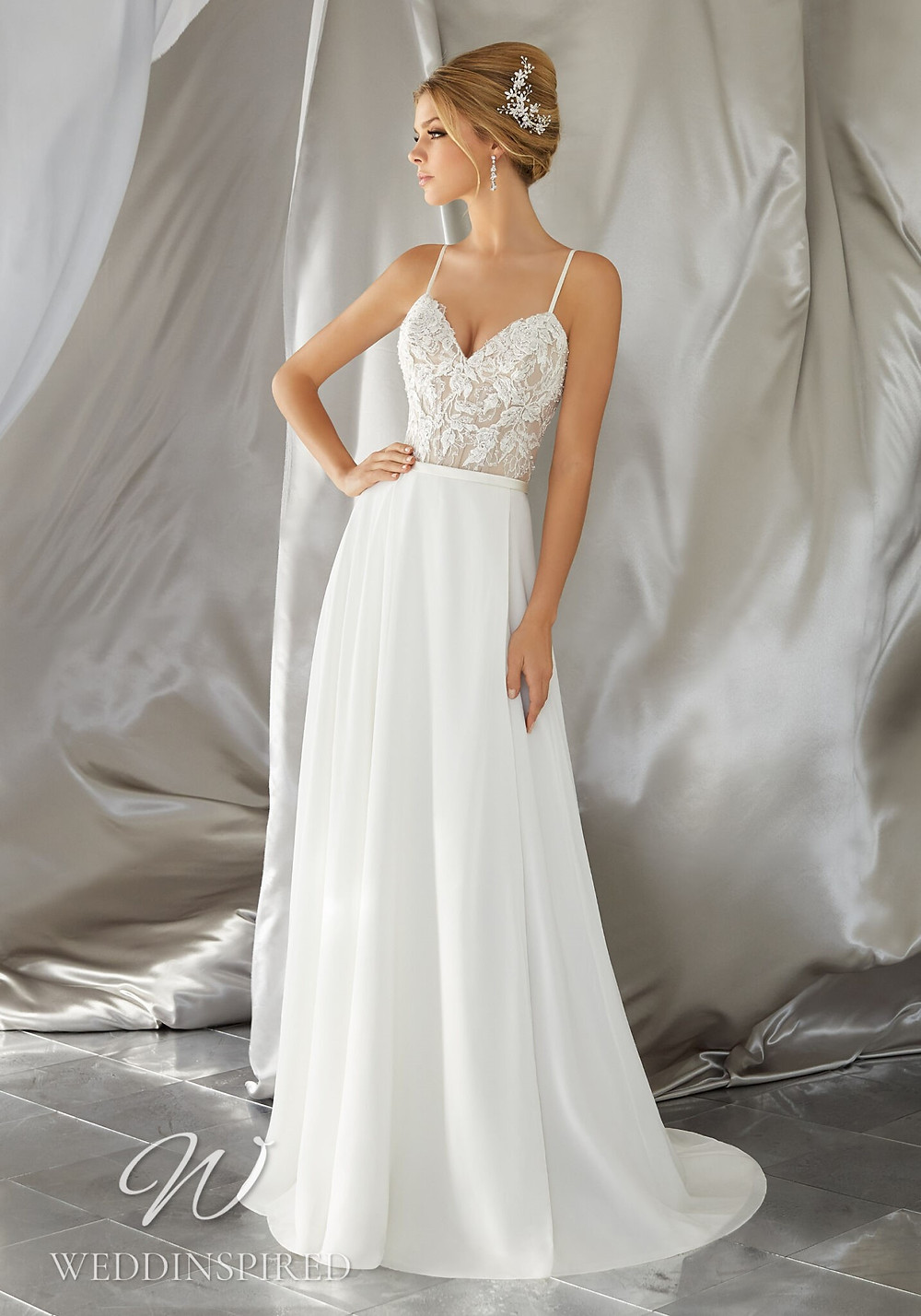 A Madeline Gardner lace and chiffon A-line wedding dress with straps