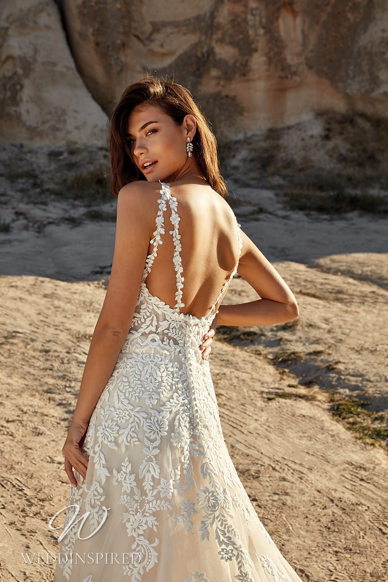 An Eddy K 2021 lace A-line wedding dress with straps