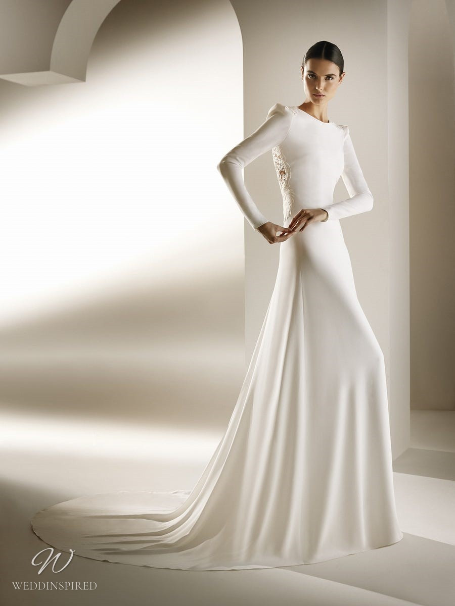 An Atelier Pronovias modest mermaid wedding dress with a high neck, lace and long sleeves