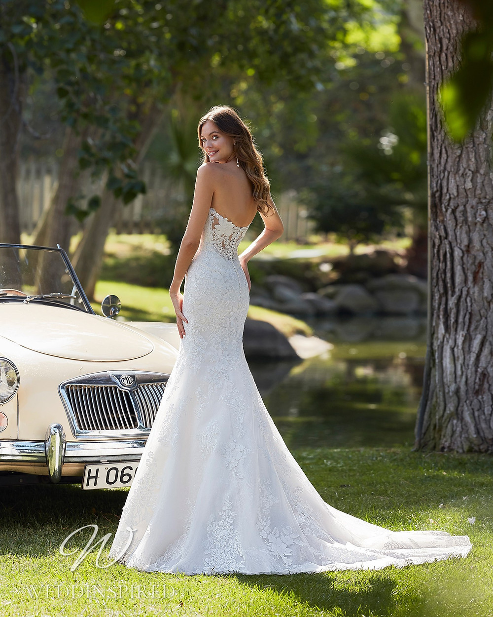 An Aire Barcelona 2021 strapless lace mermaid wedding dress