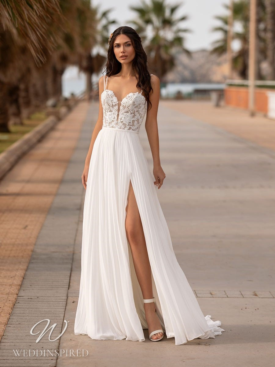 A Pronovias 2021 flowy lace and chiffon A-line wedding dress with straps and a slit
