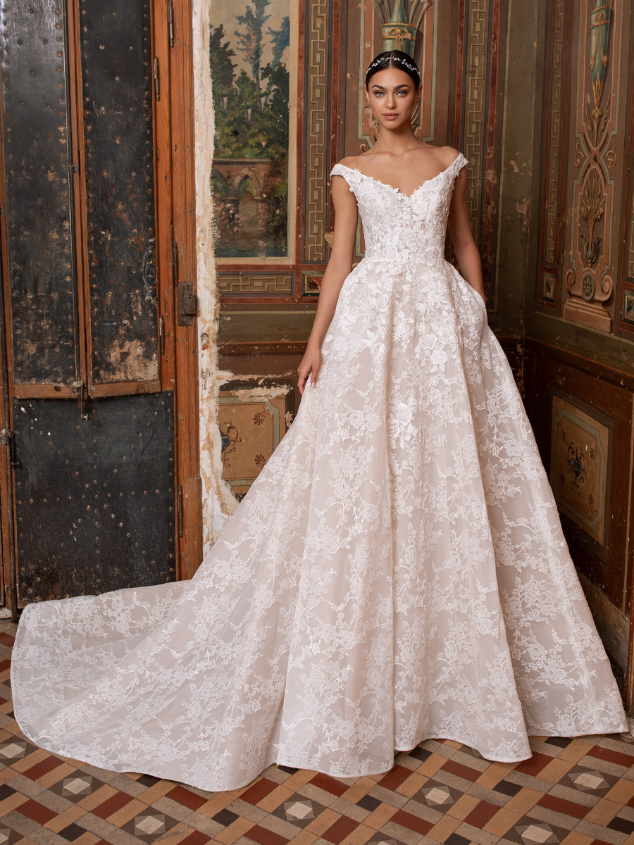 A Pronovias off the shoulder lace ball gown wedding dress with pockets