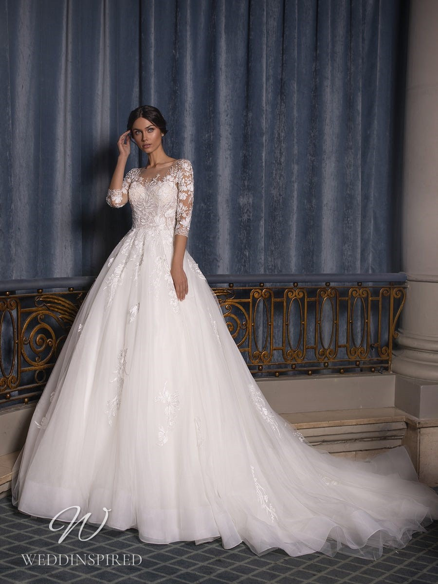 A Pronovias Privée 2021 lace and tulle ball gown wedding dress with half sleeves
