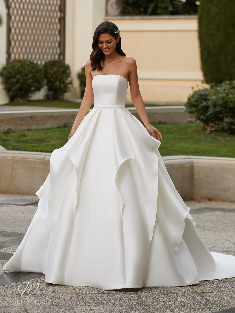A Pronovias 2021 simple strapless silk ball gown wedding dress with a ruffle skirt