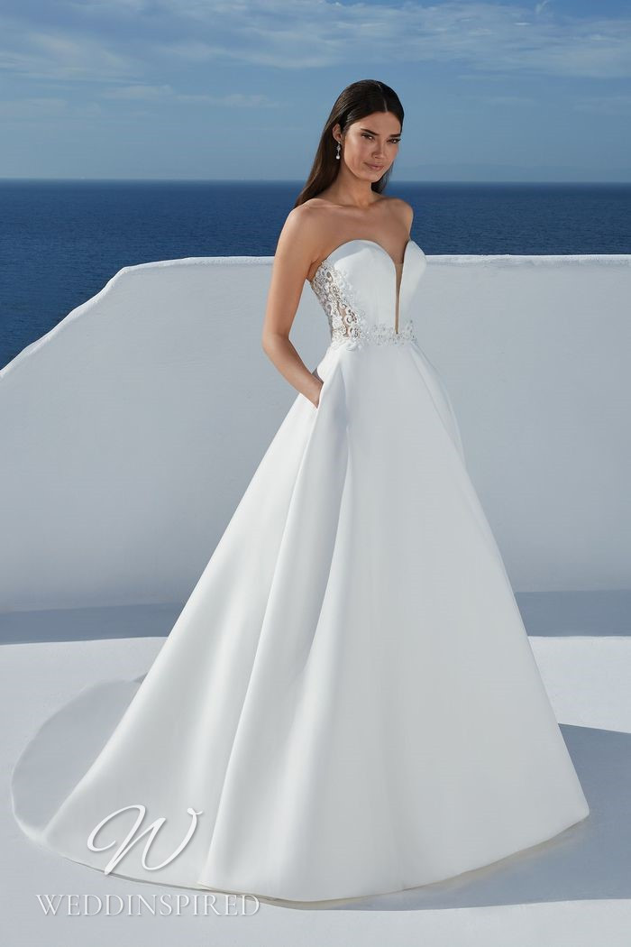 A Justin Alexander 2021 strapless satin and lace A-line wedding dress