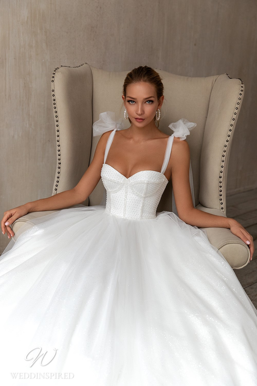 An Eva Lendel 2021 tulle ball gown wedding dress with a bustier top and tulle straps