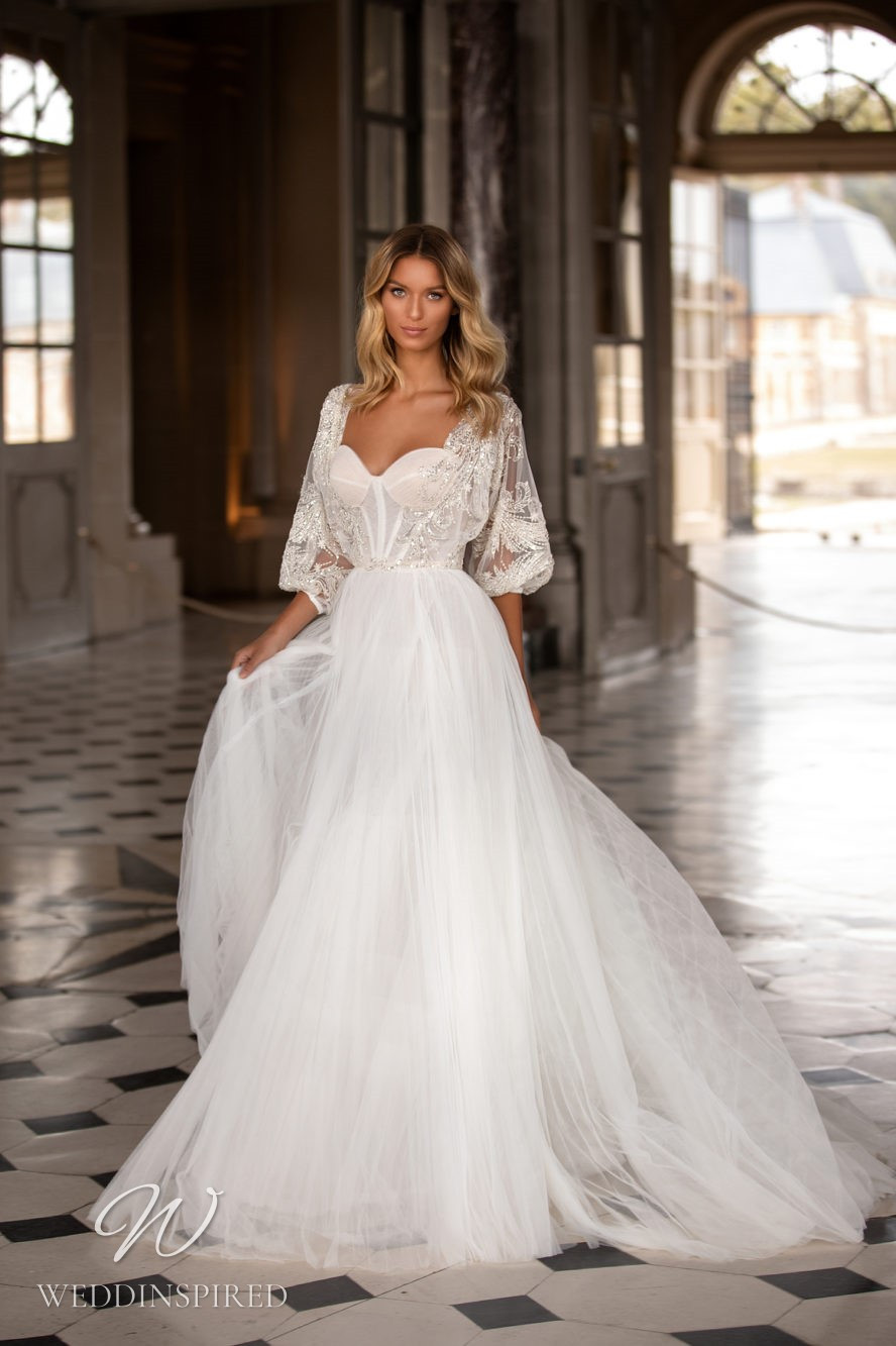 A Milla Nova princess ball gown wedding dress with a sweetheart neckline and a tulle skirt