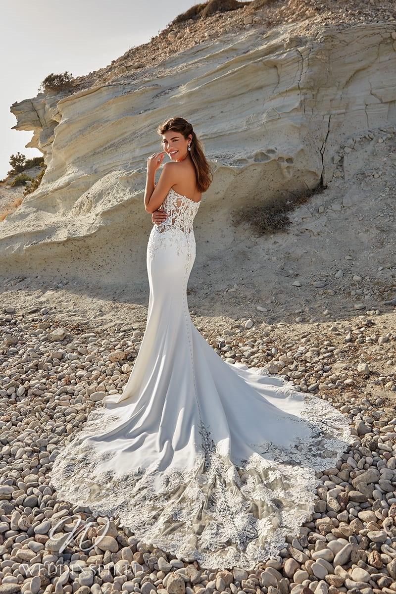 An Eddy K 2022 lace and satin mermaid wedding dress
