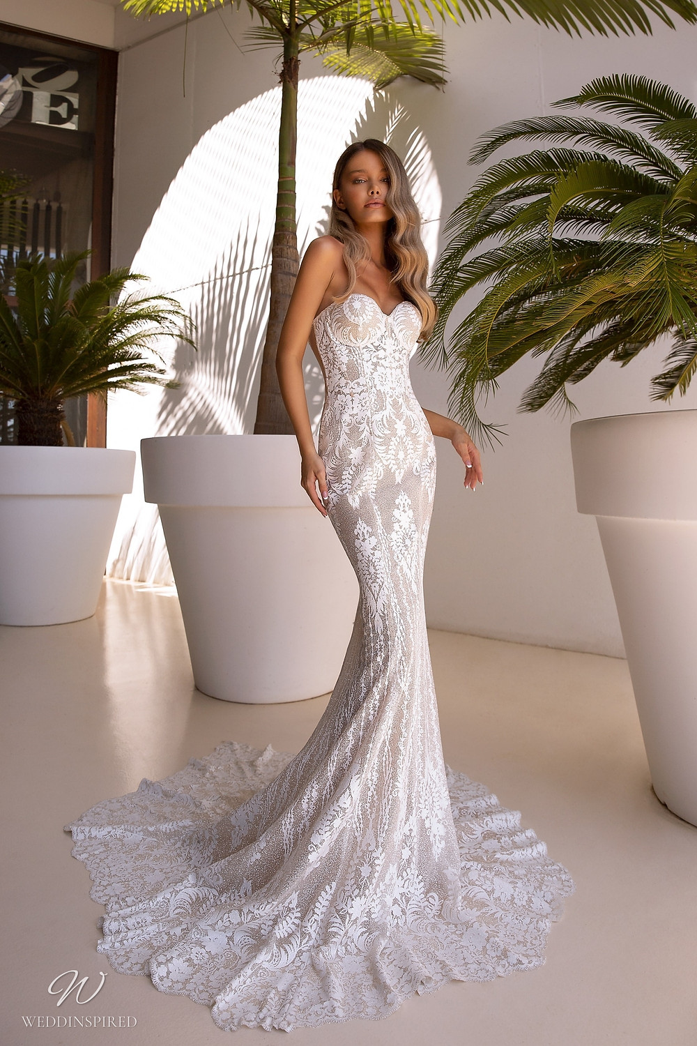 A Tina Valerdi strapless lace mermaid wedding dress with a sweetheart neckline