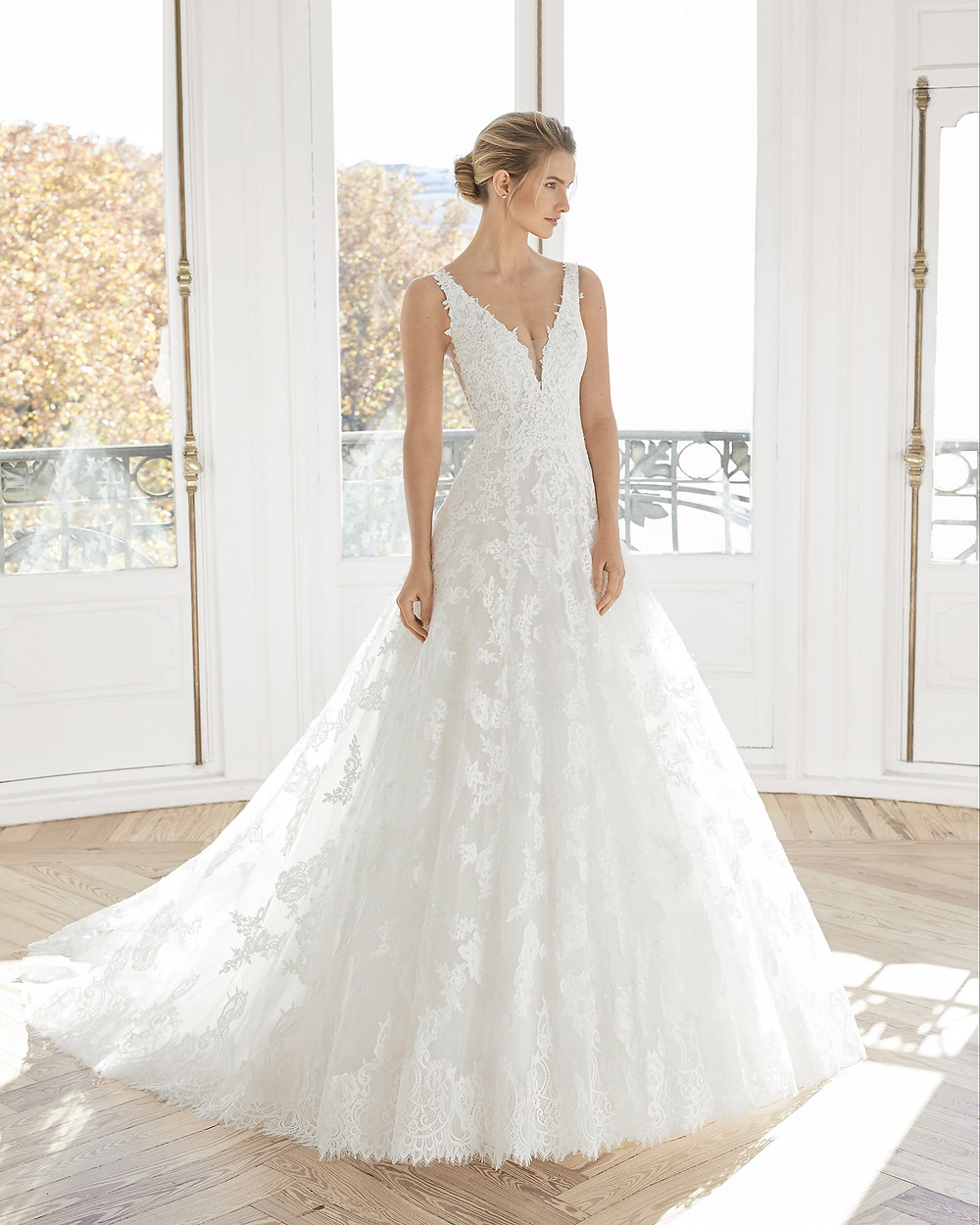An Aire Barcelona 2020 romantic lace and tulle ball gown wedding dress with straps