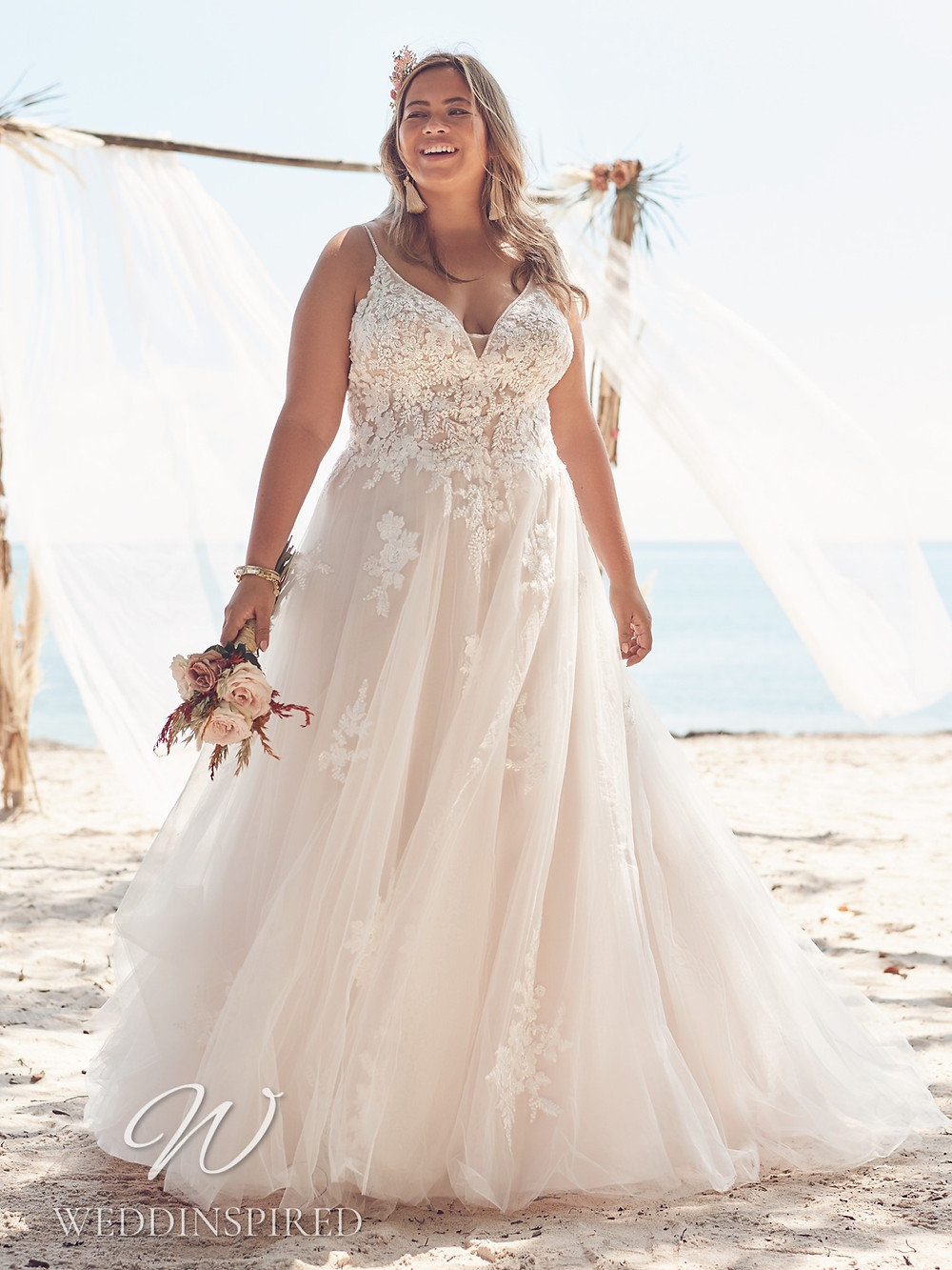 A Rebecca Ingram 2021 plus size lace and tulle A-line wedding dress