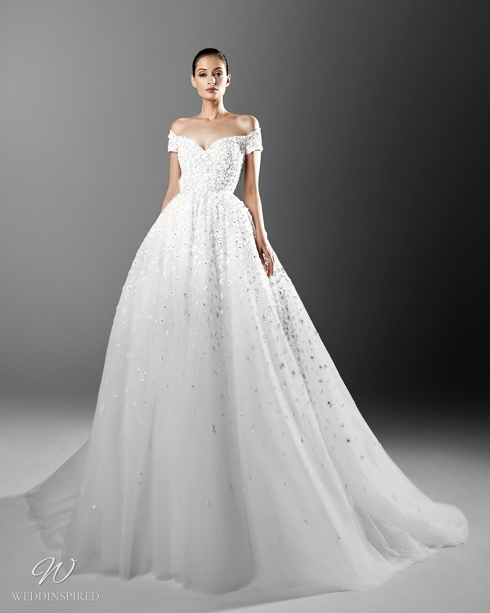A Zuhair Murad ball gown off the shoulder princess wedding dress with crystals