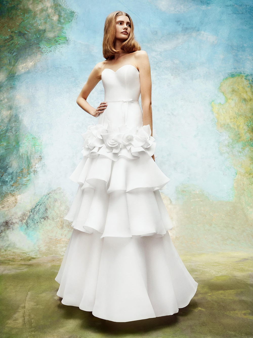 A Viktor & Rolf strapless A-line wedding dress with a layered ruffle skirt and flowers