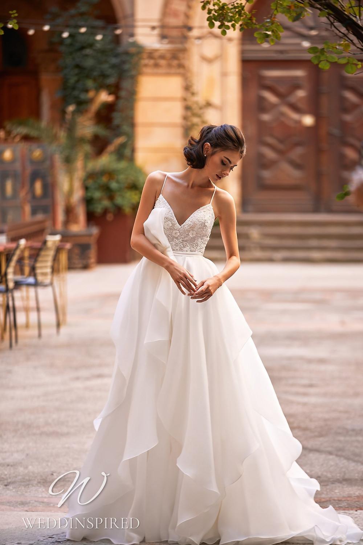 A Daria Karlozi 2021 lace and chiffon A-line wedding dress