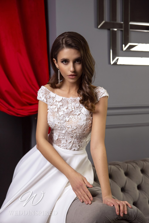 A Tina Valerdi lace and satin off the shoulder A-line wedding dress