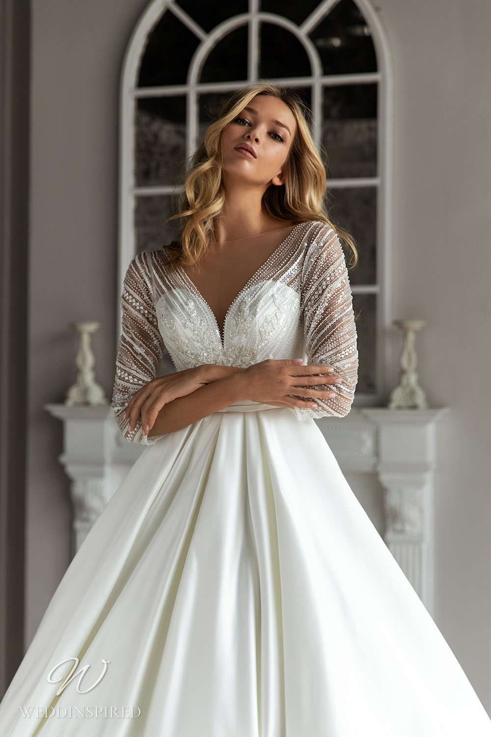 An Eva Lendel 2021 simple silk ball gown wedding dress with beaded jacket with long sleeves