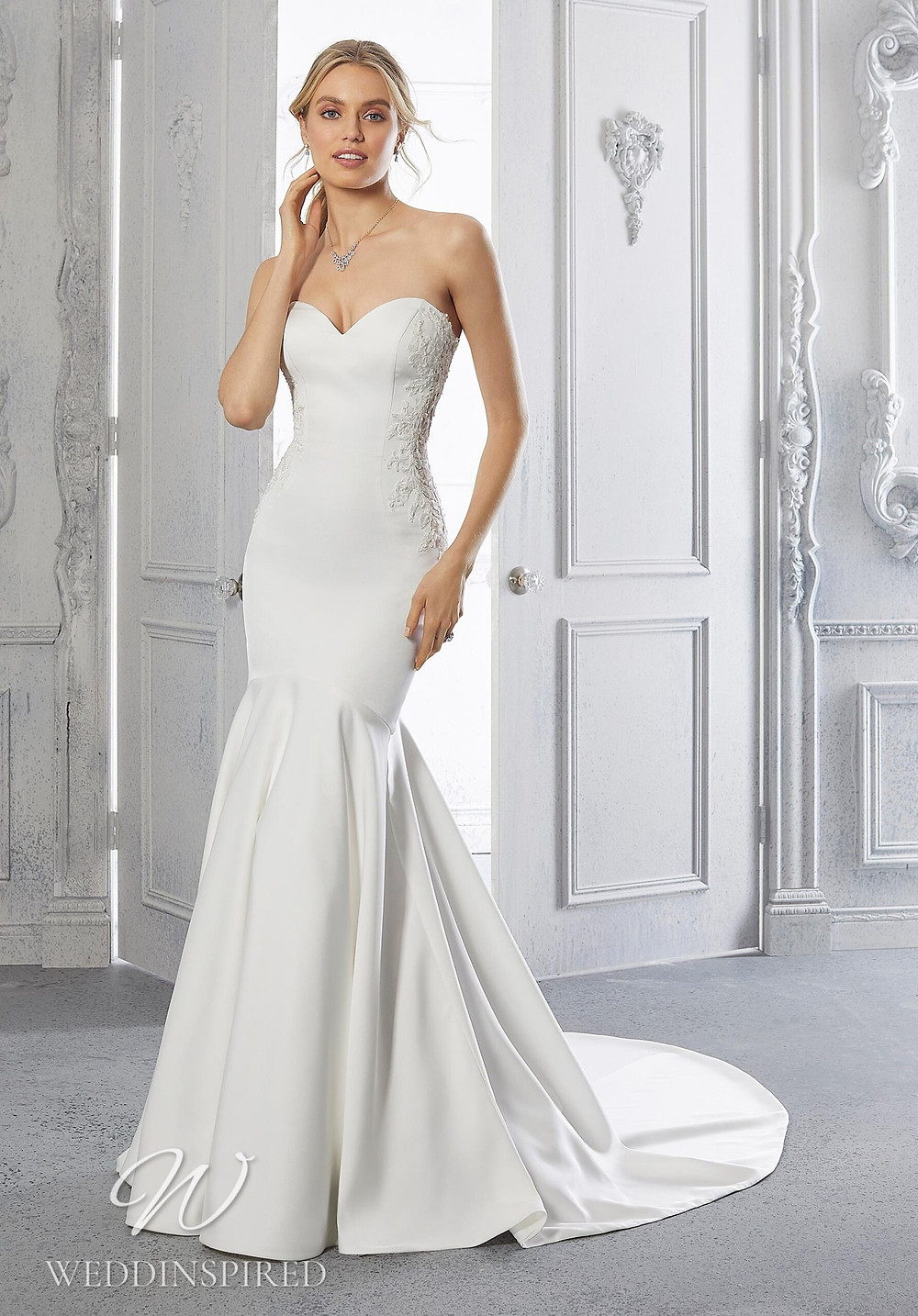 A Madeline Gardner strapless satin and lace mermaid wedding dress