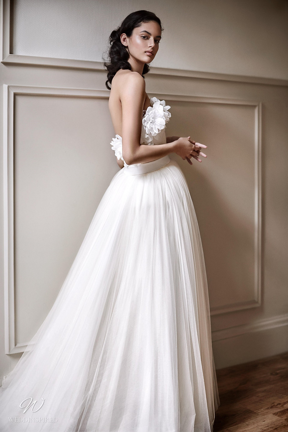 A Viktor & Rolf 2021 strapless princess ball gown wedding dress with chiffon skirt and flowers