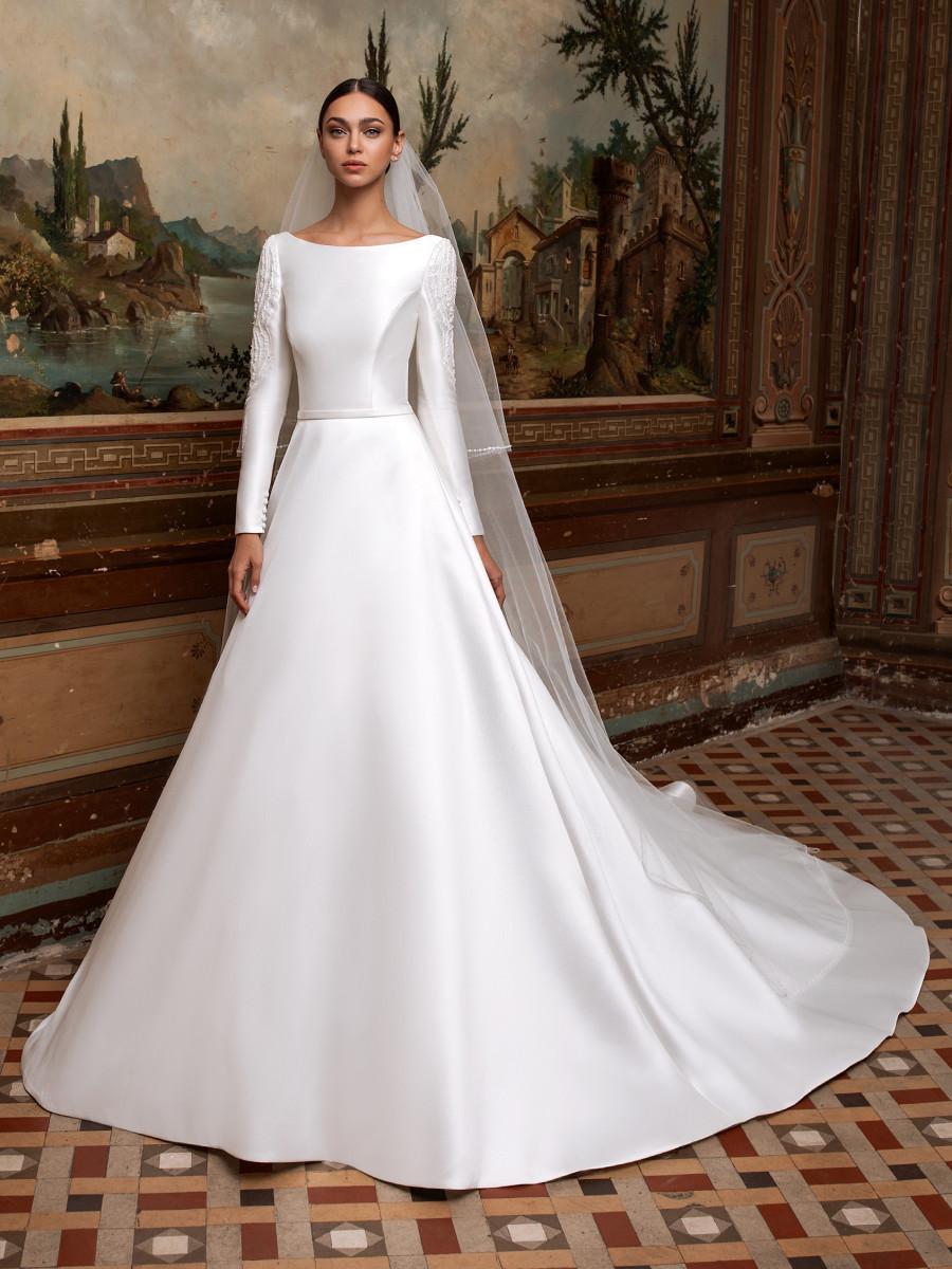 A Pronovias modest silk satin ball gown wedding dress with long sleeves