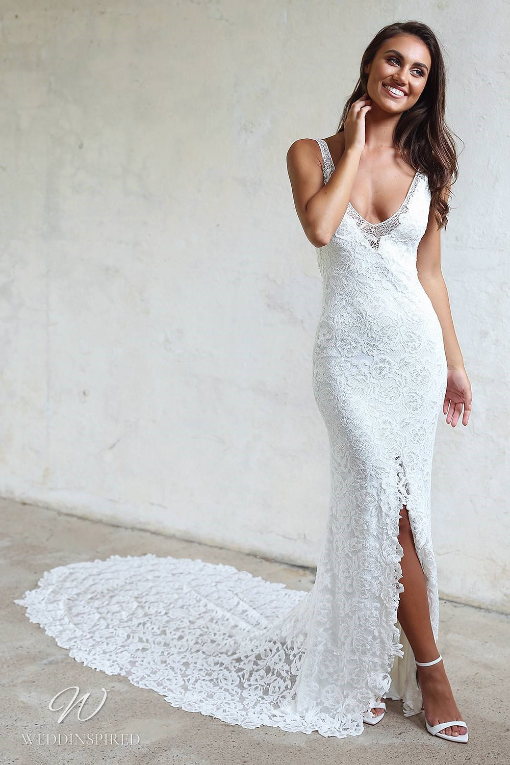 A Grace Loves Lace mermaid lace wedding dress with a high slit, train and a v neck