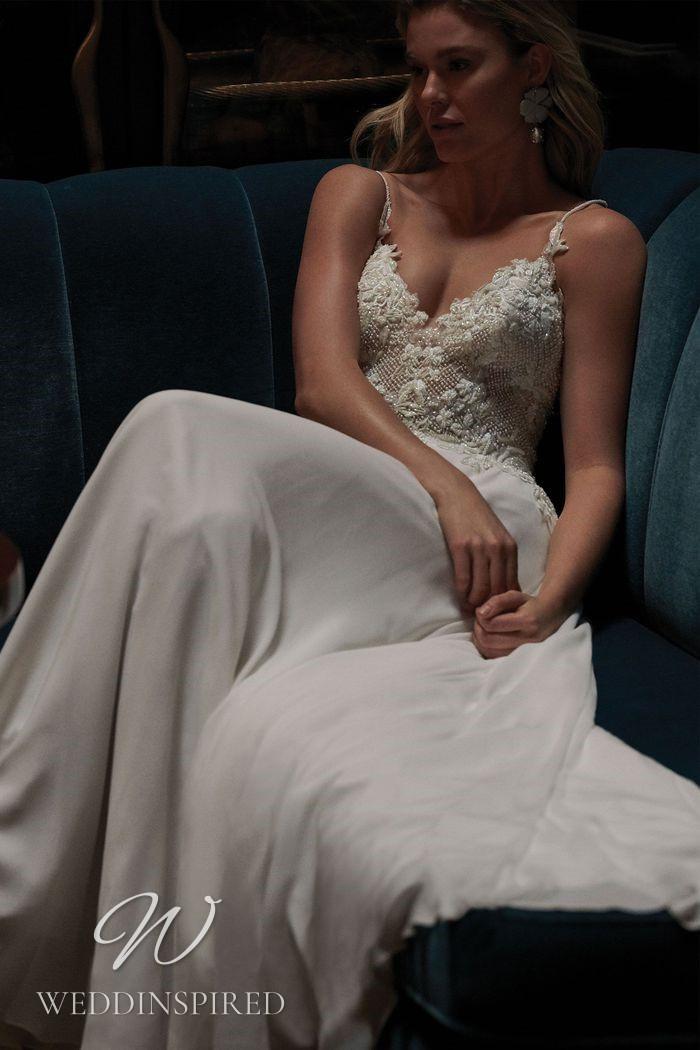 A Justin Alexander 2021 lace and chiffon sheath wedding dress