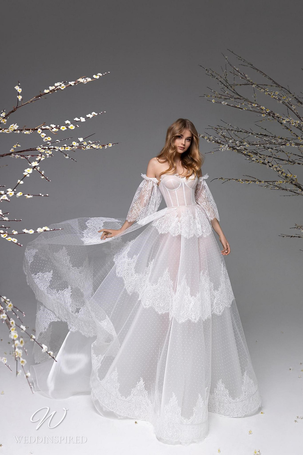 A Ricca Sposa tulle and lace ball gown wedding dress