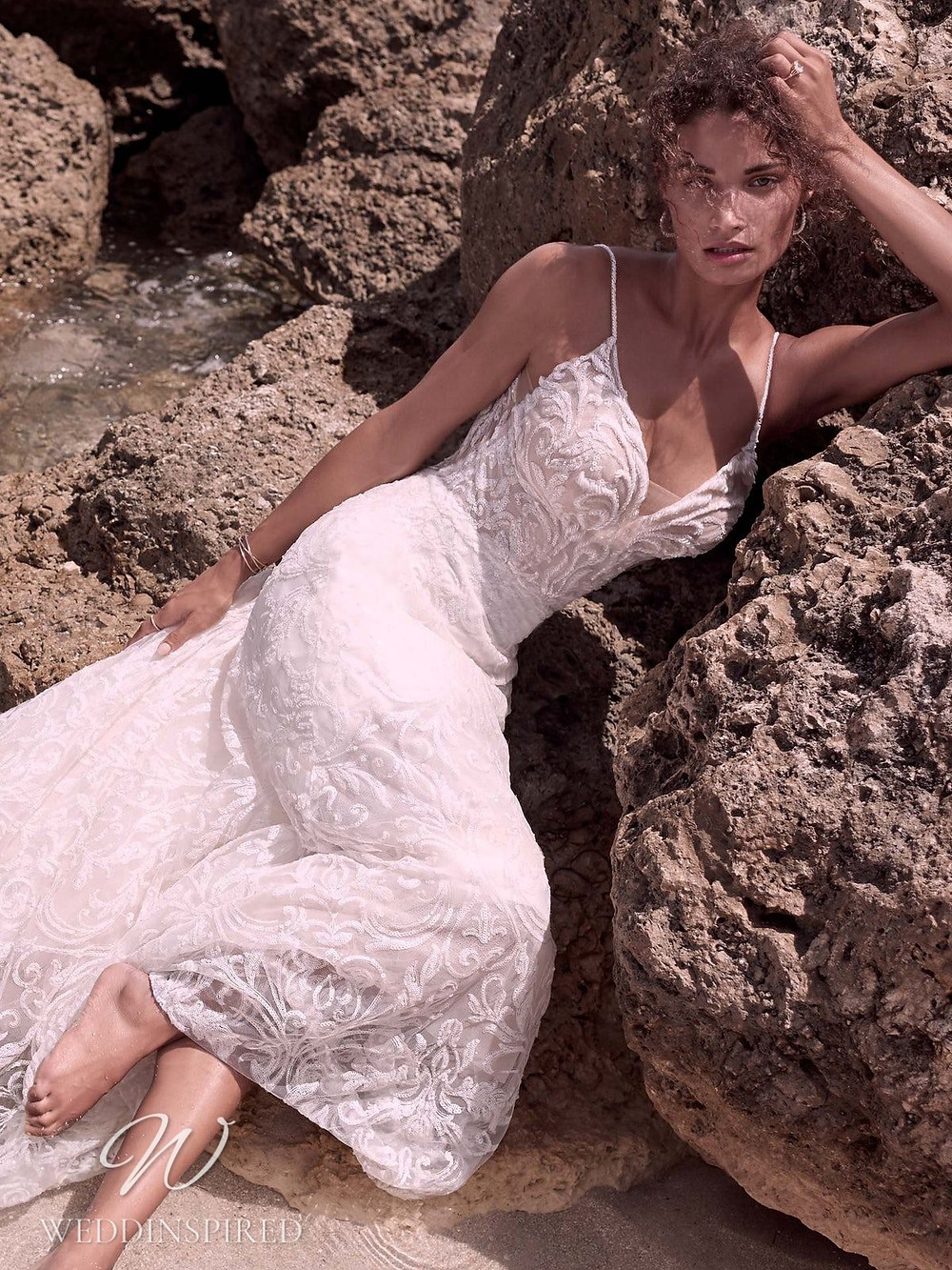 A Sottero & Midgley Spring 2021 lace mermaid wedding dress with thin straps and a v neck