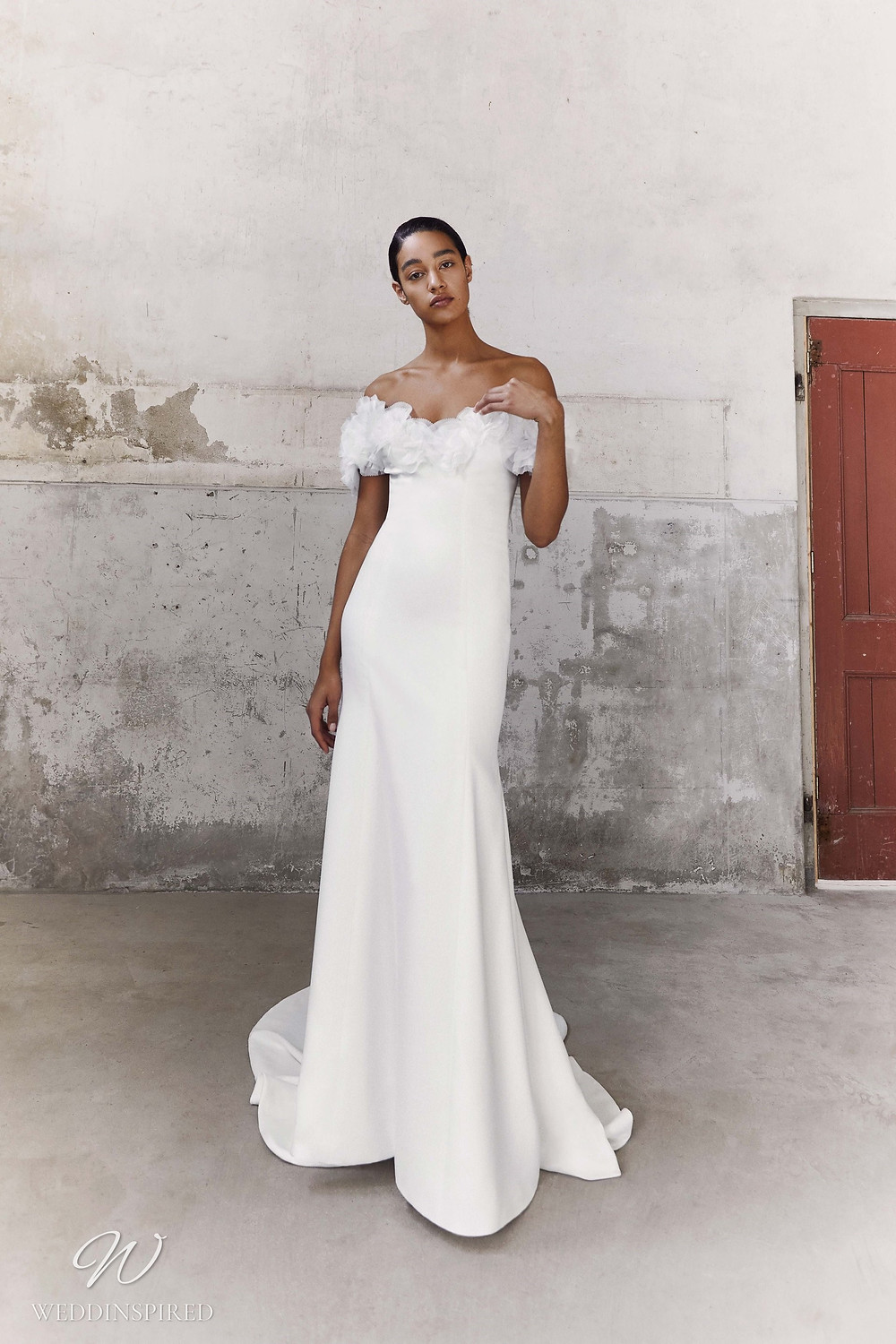 A Viktor & Rolf Fall/Winter 2021 simple off the shoulder sheath wedding dress with tulle ruffles