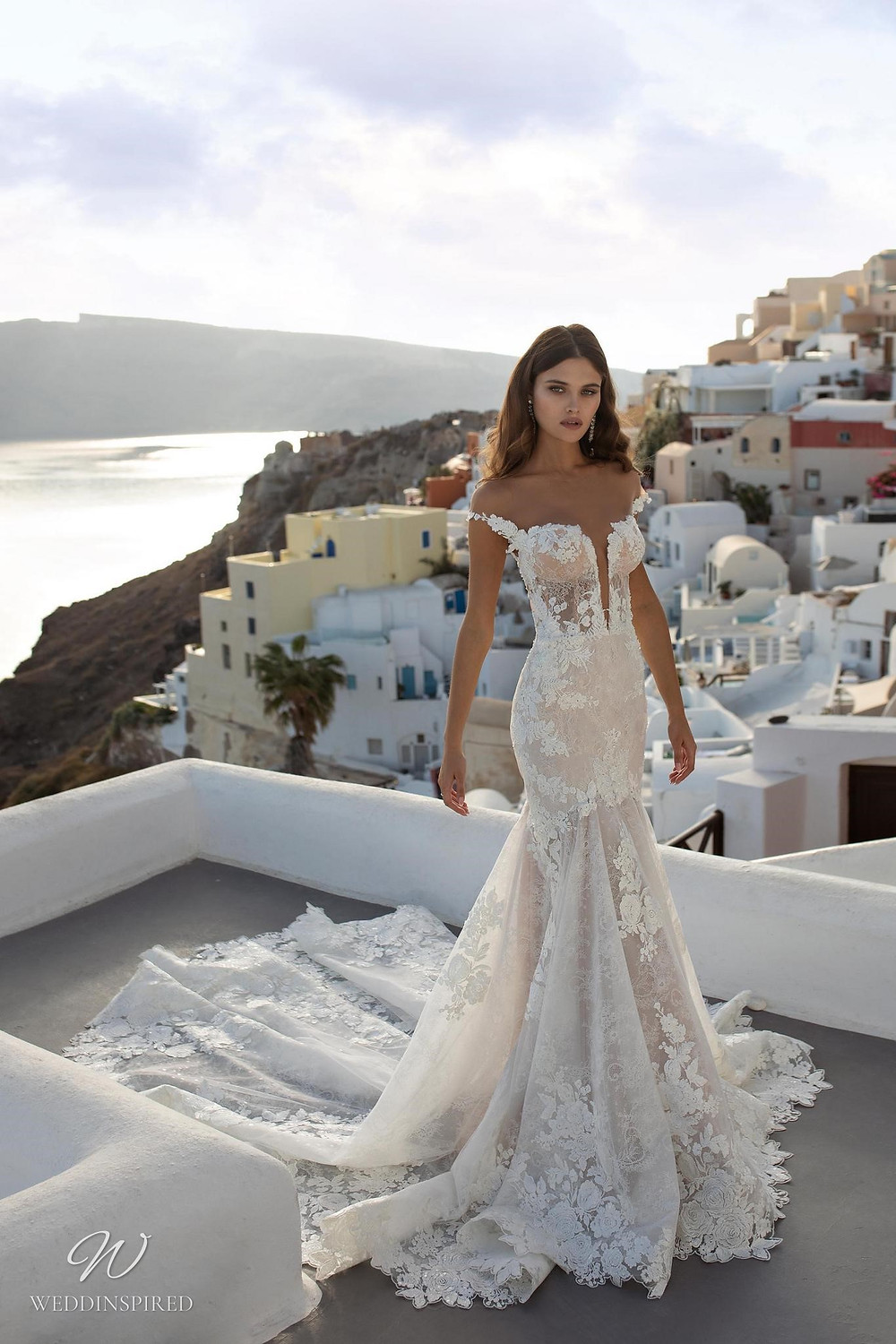 A Ricca Sposa off the shoulder lace mermaid wedding dress with a sweetheart neckline and a train