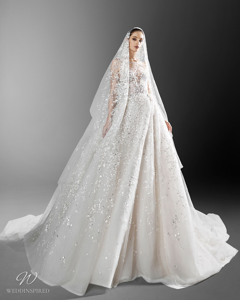 A Zuhair Murad sparkling crystal princess ball gown wedding dress with an illusion neckline and a veil