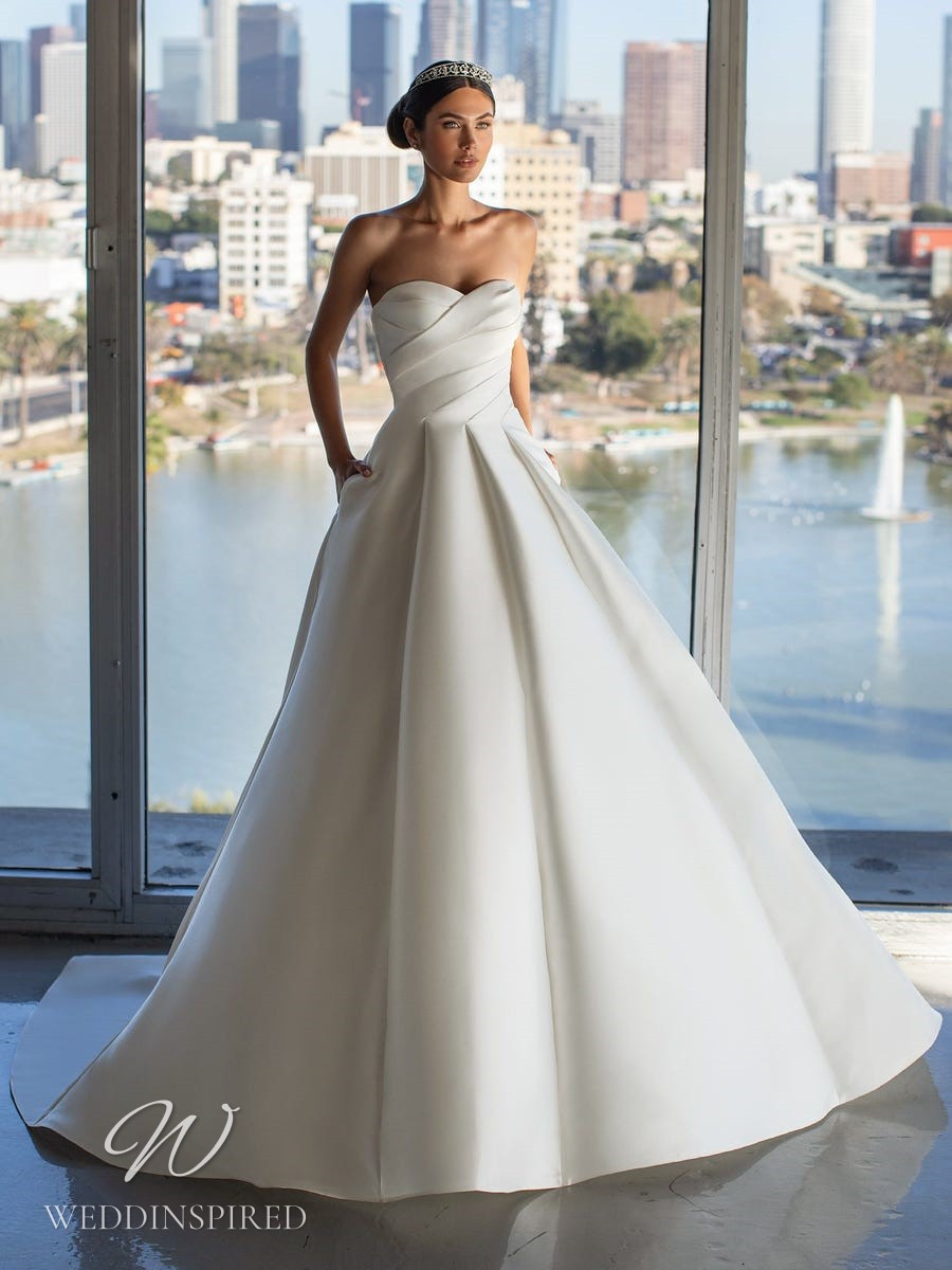A Pronovias 2021 simple strapless satin ball gown wedding dress with pockets