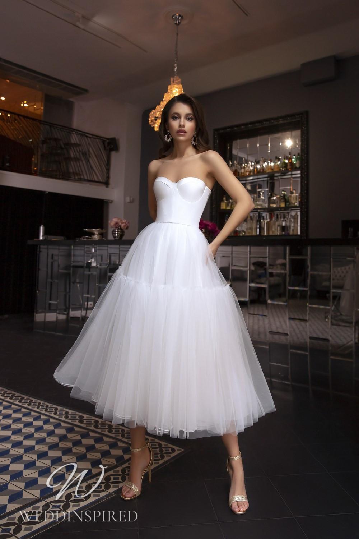 A Tina Valerdi strapless satin and tulle tea length wedding dress
