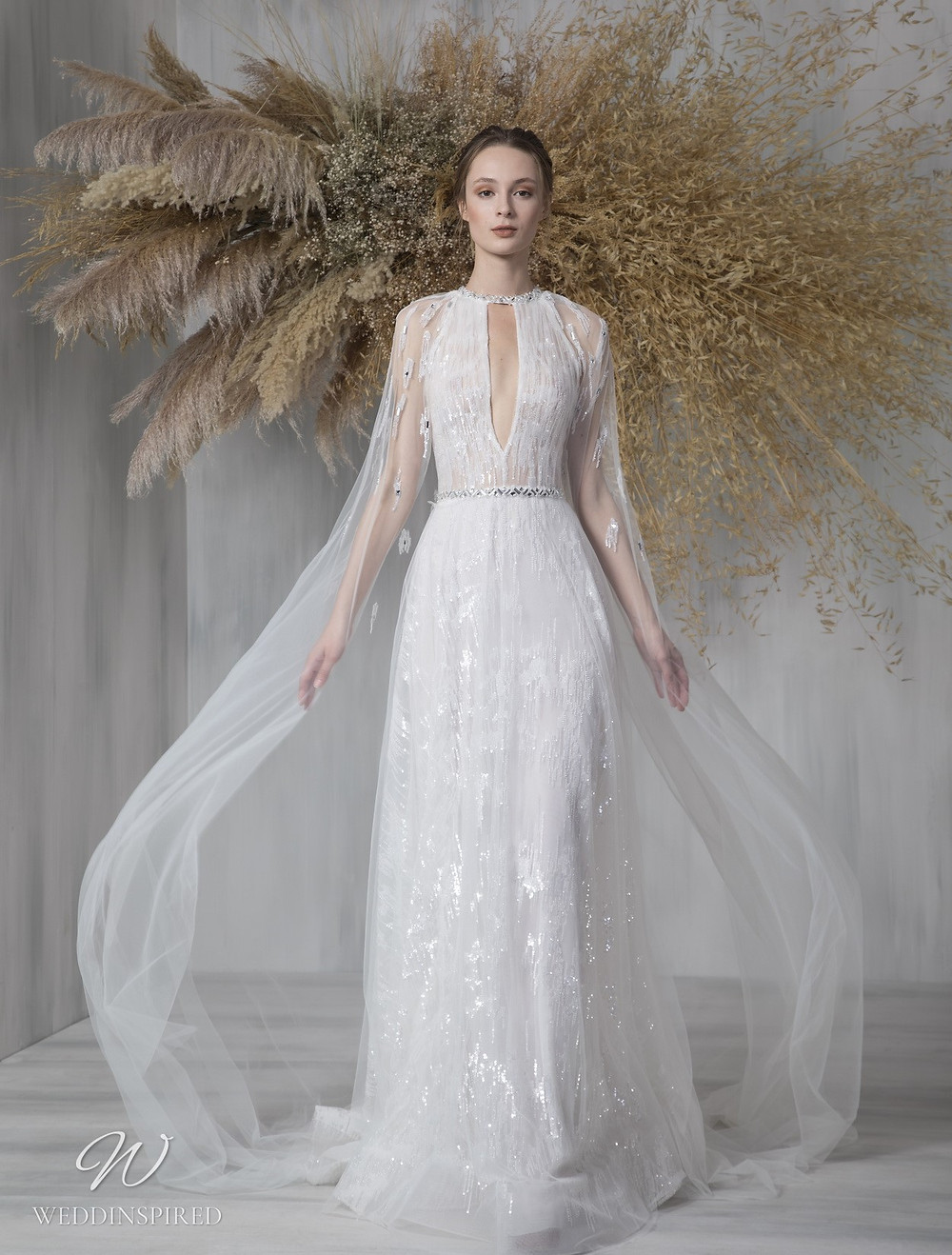 A Tony Ward 2021 sparkly halterneck sheath wedding dress with a cape