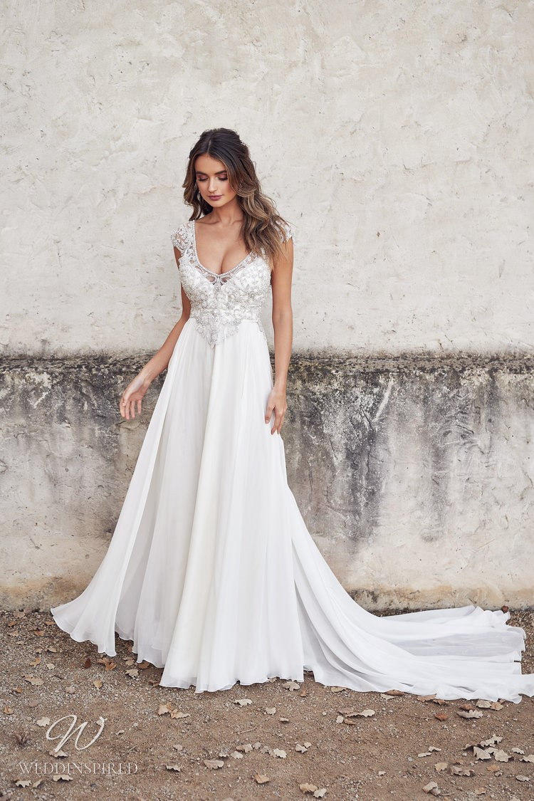 An Anna Campbell 2020 chiffon A-line wedding dress with a v neck, straps and beading