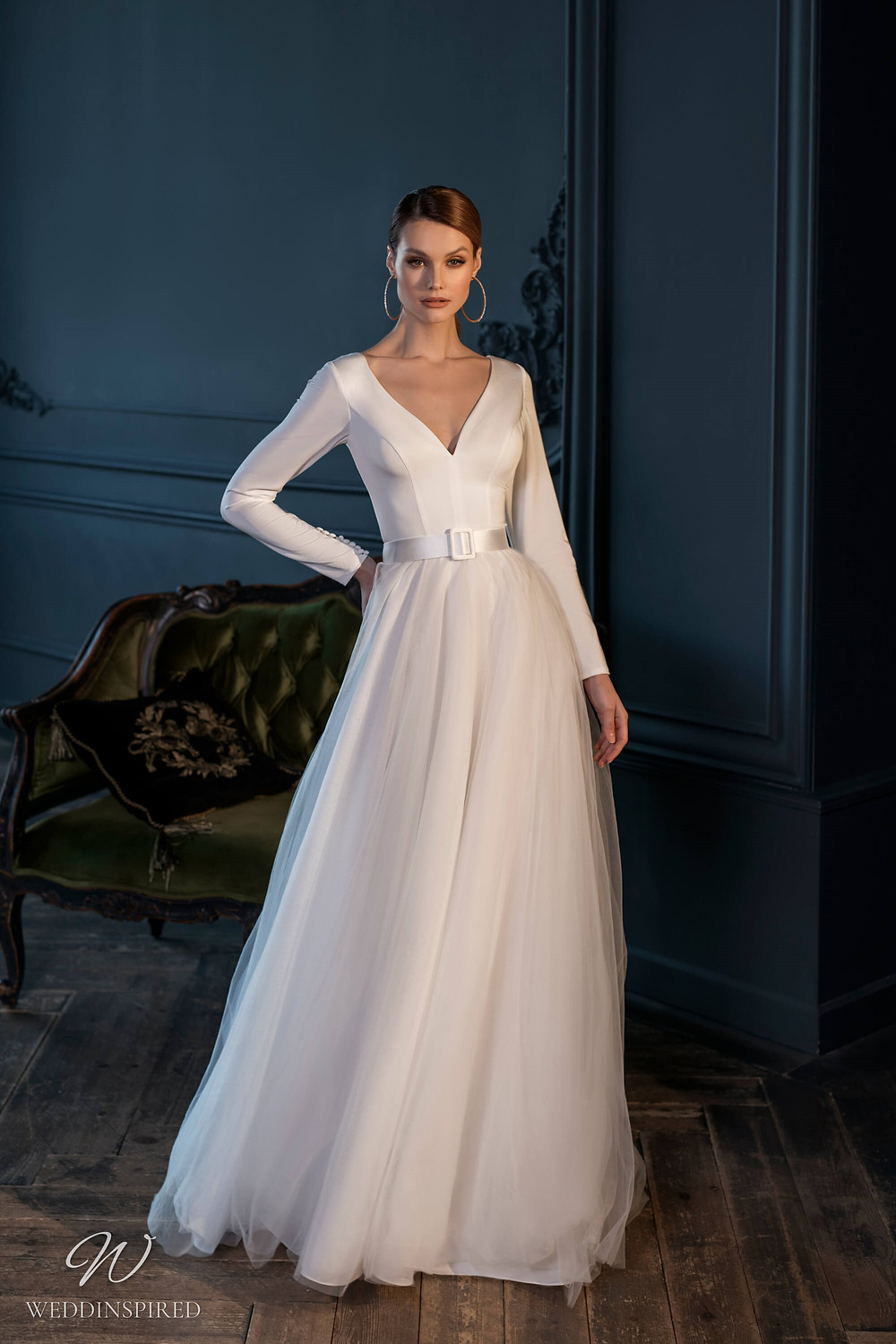 A Naviblue Bridal 2021 tulle and silk A-line wedding dress with long sleeves and a belt