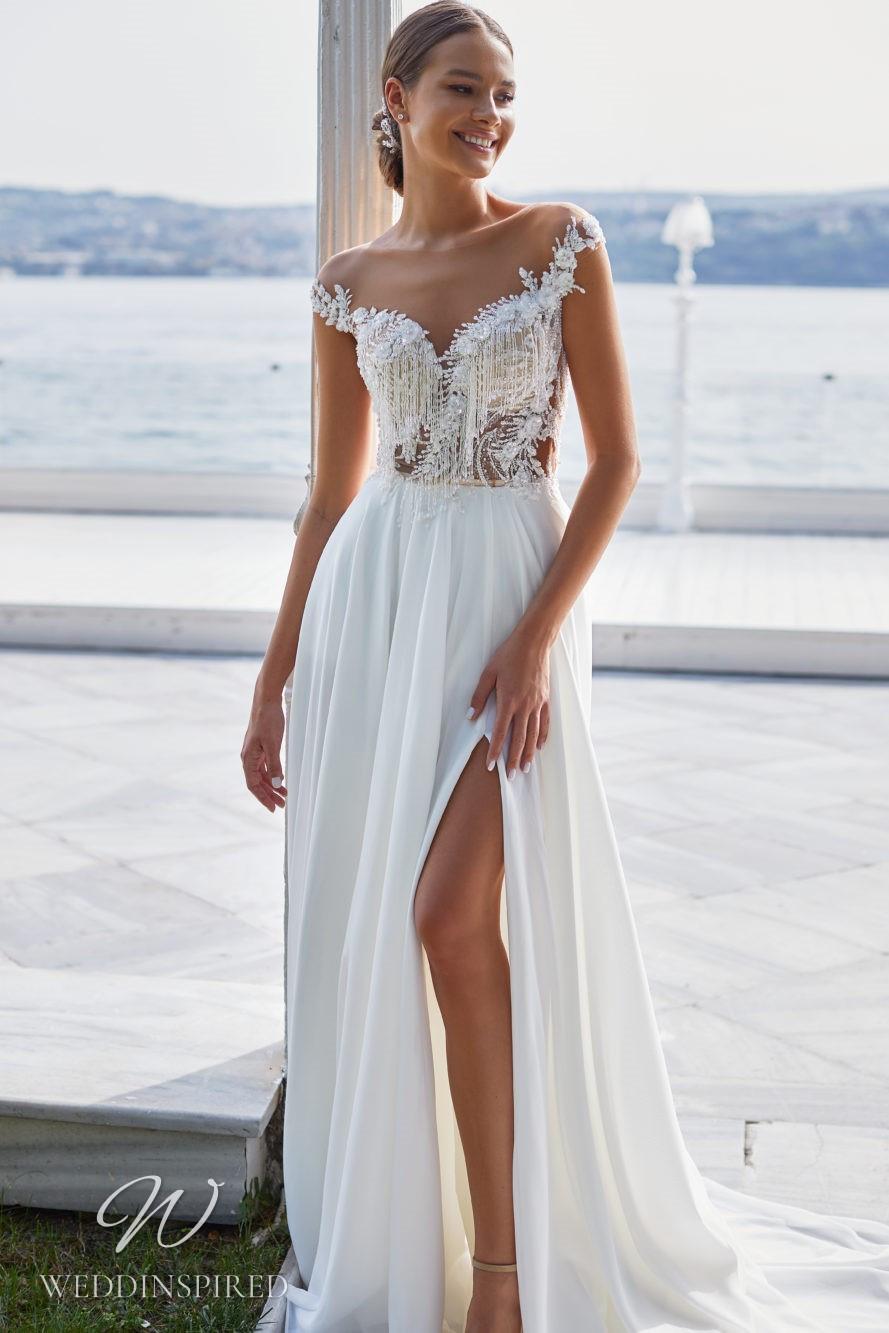 A Milla Nova 2021 sparkly off the shoulder chiffon A-line wedding dress with a slit