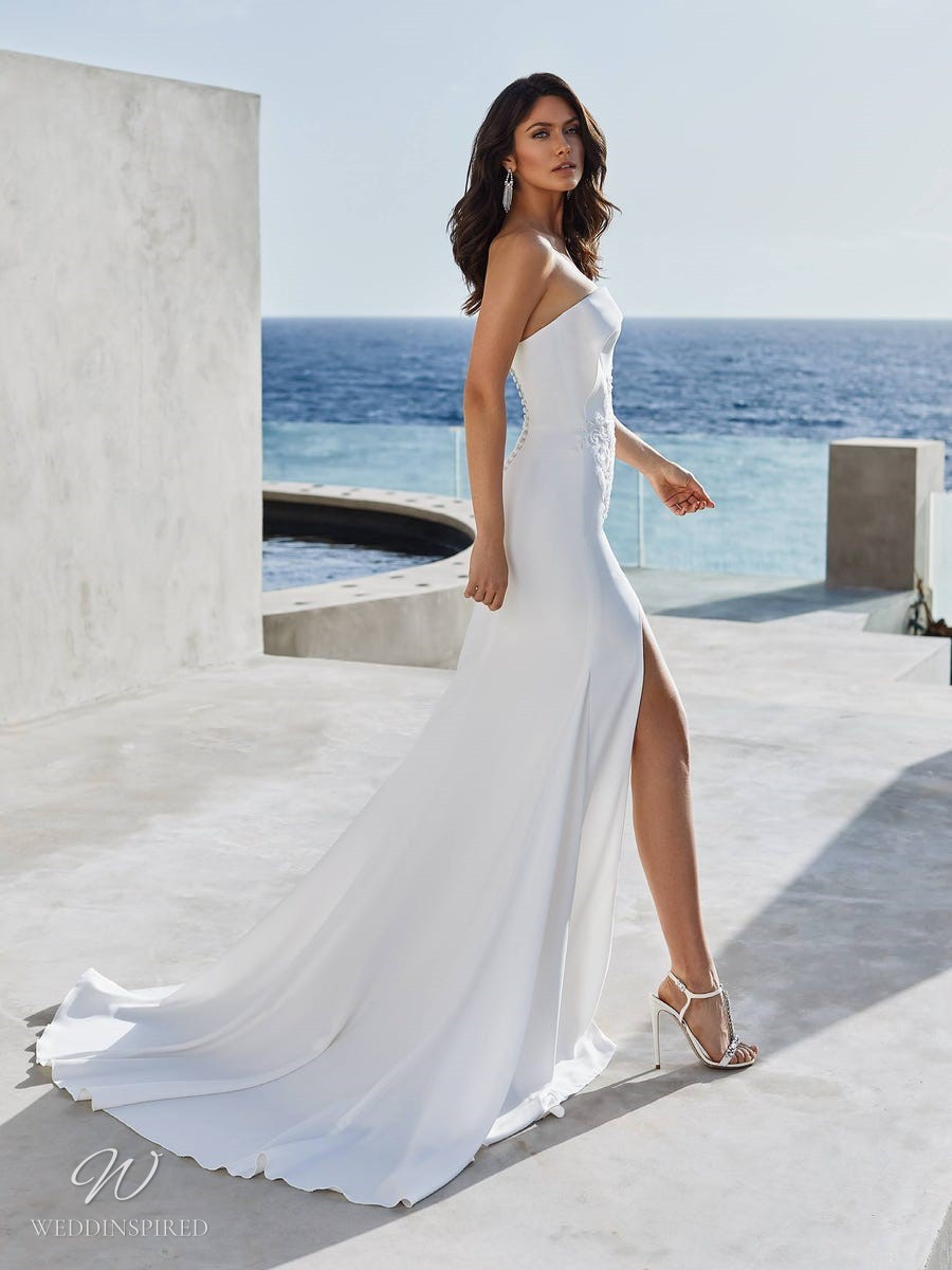 A Pronovias 2021 simple strapless sheath wedding dress with a high slit and a train