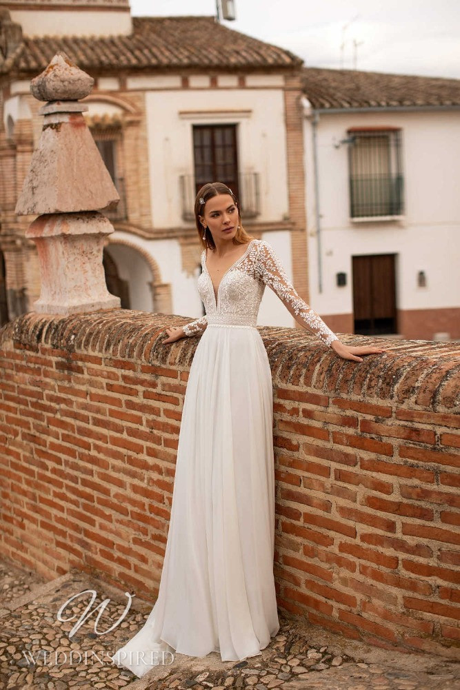 A Nora Naviano 2021 boho lace and tulle sheath wedding dress with long sleeves