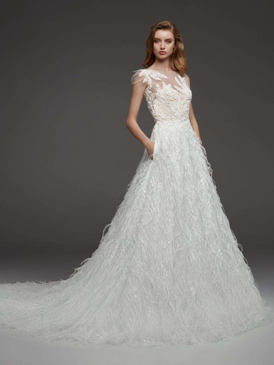 A Pronovias lace and feathers ball gown wedding dress with pockets