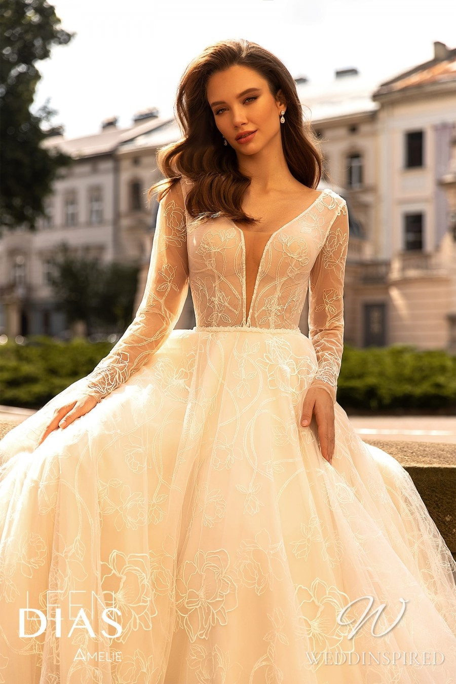 A Leen Dias 2021 ivory lace and tulle A-line wedding dress with long sleeves